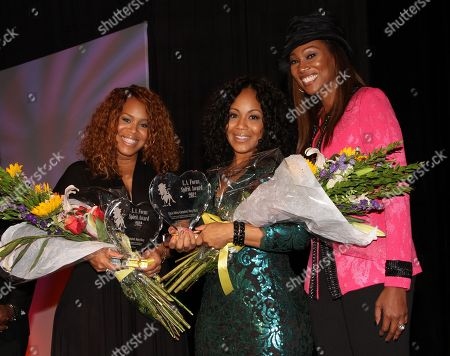 """Honorees Trecina """"Tina"""" Atkins-Campbell, Erica Atkins-Campbell of Gospel duo Mary Mary and Yolanda Adams backstage at LA Focus 15th Annual First Ladies High Tea at Beverly Hilton Hotel, in Bevrly Hills, California"""