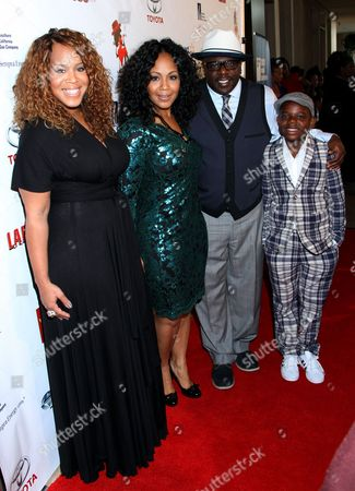 """L-R) Honorees Trecina """"Tina"""" Atkins-Campbell, Erica Atkins-Campbell of Gospel duo Mary Mary, Cedric the Entertainer and son Croix Kyles attend LA Focus 15th Annual First Ladies High Tea at Beverly Hilton Hotel, in Bevrly Hills, California"""