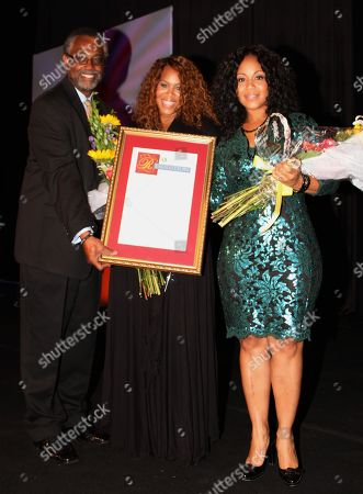 """L-R) Senator Curren D. Price, honorees Trecina """"Tina"""" Atkins-Campbell and sister Erica Atkins-Campbell of Gospel duo Mary Mary backstage at LA Focus 15th Annual First Ladies High Tea at Beverly Hilton Hotel, in Bevrly Hills, California"""