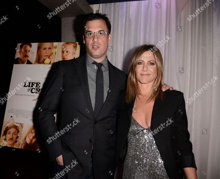 "Director Daniel Schechter, left, and actress Jennifer Aniston attend the premiere of the feature film ""Life of Crime"" at the ArcLight Hollywood on in Los Angeles"