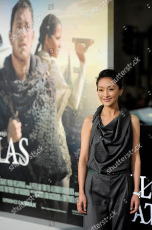 "Chinese actress Xun Zhou, a cast member in ""Cloud Atlas,"" poses with his wife, actress Rita Wilson, at the premiere of the film at Grauman's Chinese Theatre, in Los Angeles"