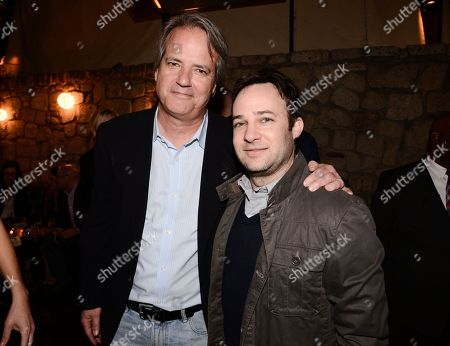 """Actor Danny Strong, right, and executive producer Graham Yost attend an after party for the screening of the television series finale of FX's """"Justified"""" in Los Angeles on"""