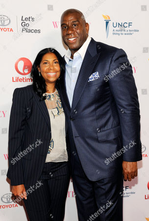"""Earvin """"Magic"""" Johnson and his wife Cookie pose together at the premiere of the film """"Whitney"""" at the Paley Center for Media, in Beverly Hills, Calif"""
