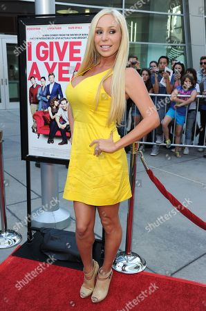 """Mary Carey arrives at a special screening for """"I Give It A Year"""" at the ArcLight Hollywood on in Los Angeles"""