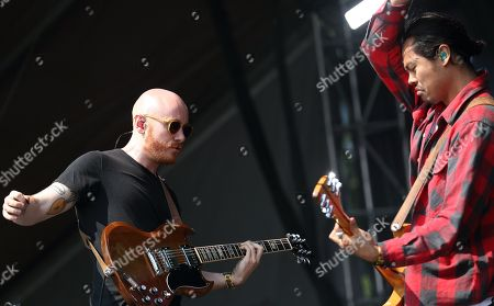 Joseph Greer (L) and Dougy Mandagi (R) from the band The Temper Trap perform at Lollapalooza in Chicago's Grant Park on