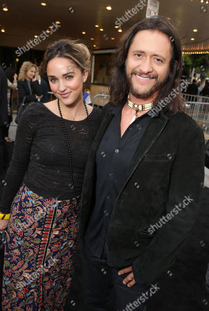 Megan Ozurovich and Clifton Collins Jr. seen at the Los Angeles Premiere of Alcon Entertainment's 'Transcendence', on in Westwood, Calif