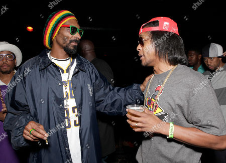 Snoop Dogg and David Blake aka DJ Quik arrive at the Mac and Devin Go to High School DVD Preview featuring Snoop Dogg and Wiz Khalifa on in Los Angels