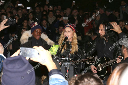 Singer Madonna, right, and her son David Banda perform in support of Democratic presidential candidate Hillary Clinton at Washington Square Park, in New York