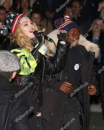 Stock Image of Madonna, left, and her son David Banda perform in support of the Hillary Clinton campaign at Washington Square Park, in New York