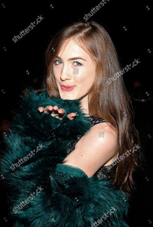 Actress Emma Holzer attends the Anna Sui 2014 Fall/Winter Collection during Mercedes Benz Fashion Week, in New York