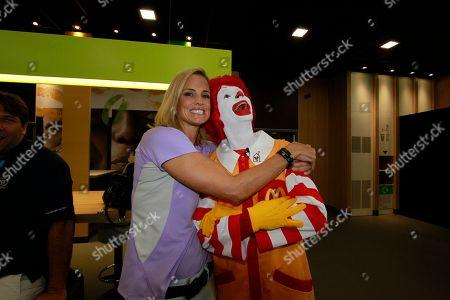 Olympian Dara Torres hugs Ronald McDonald at the McDonald's London 2012 Olympic Games Press Event, in London, England