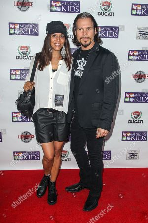 """Christine Devine, left, and Sean McNabb attend the """"Music On A Mission"""" benefit concert held at Lucky Strike Live - Hollywood on in Los Angeles"""