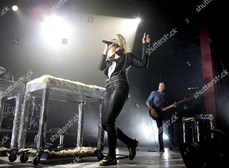 Stock Image of Emily Haines, left, and Joshua Winstead of the band Metric perform in concert during their I Can See The End Tour 2016 at the Fillmore, in Philadelphia