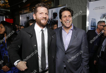 Screenplay Writer Joshua Zetumer and President, Motion Picture Group for MGM Jonathan Glickman seen at Metro-Goldwyn-Mayer and Columbia Pictures Los Angeles premiere of 'Robocop', on Monday, Feb, 10, 2014 in Los Angeles