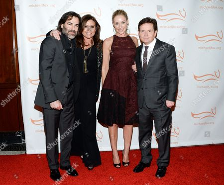 "Actor Michael J. Fox and wife Tracy Pollan, right, pose with chef Rachael Ray and husband John Cusimano at ""A Funny Thing Happened on the Way to Cure Parkinson's"", to benefit The Michael J. Fox Foundation for Parkinson's Research, at the Waldorf Astoria, in New York"