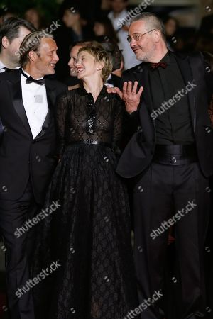 From left, actors Mads Mikkelsen, Delphine Chuillot and director Arnaud des Pallieres arrive for the screening of Michael Kohlhaas at the 66th international film festival, in Cannes, southern France