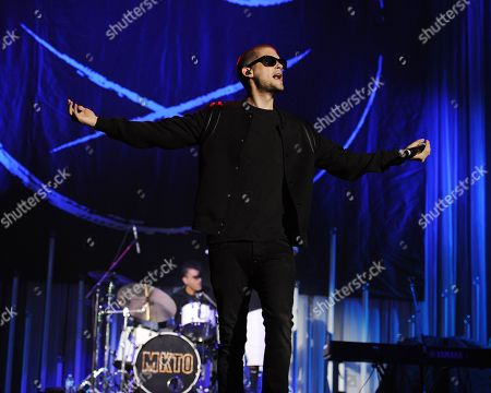 Tony Oller of MKTO performs during the Demi World Tour at the American Airlines Arena on in Miami, Florida