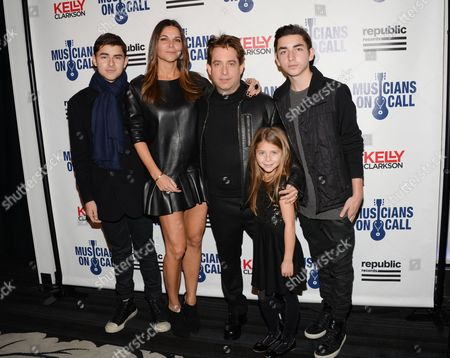 Republic Records executive vice president Charlie Walk and family attend Musicians On Call 15th Anniversary at Espace, in New York