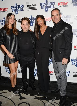 Republic Records executive vice president Charlie Walk and wife Lauren and Republic Records Chairman and CEO Monte Lipman and wife Angela attend Musicians On Call 15th Anniversary at Espace, in New York