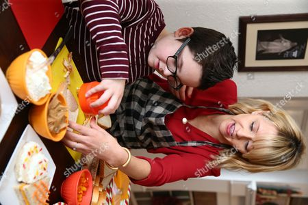 Brigham Tilltoson gets tips from Celebrity Chef Kelsey Nixon at Nature's Harvest� bread's Kitchen Crash at the Tillotson residence, in Forney, TX