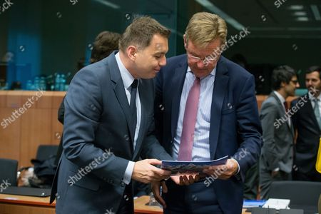 Slovakia's Minister of Finance Peter Kazimir (L) and Belgian Minister of Finance responsible for the Fight against Tax Fraud Johan Van Overtveldt (R) talk at the start of a Eurogroup Finance Ministers meeting in Brussels, Belgium, 06 November 2017.