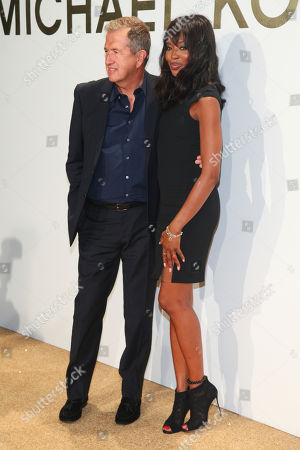 Vladimir Doronin, left, and Naomi Campbell, right, attend the New York Fashion Week Spring/Summer 2016 Michael Kors Gold Collection Fragrance Launch at The Top of the Standard, in New York