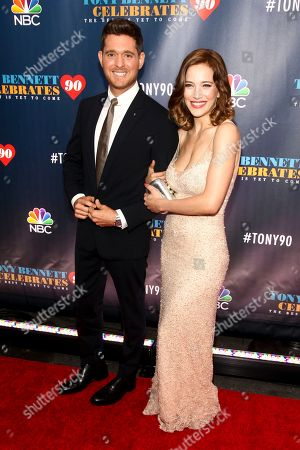 """Stock Picture of Michael Buble, left, and wife Luisana Lopilato, attend """"Tony Bennett Celebrates 90: The Best Is Yet to Come"""" at Radio City Music Hall, in New York. Buble says his 3-year-old son Noah has been diagnosed with cancer and is undergoing treatment in the U.S. The singer and Lopilato, made the announcement about their son, Noah, on . Buble says he and his wife """"have put our careers on hold in order to devote all our time and attention to helping Noah get well"""