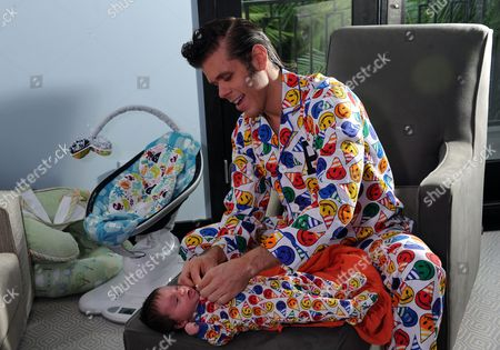 Stock Photo of Perez Hilton poses for a photo with his son Mario Armando Lavandeira III at his Pajama Birthday Party at the El Rey Theatre on in Los Angeles