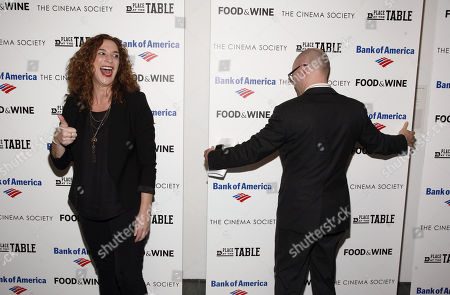 """Director Kristi Jacobson poses for photos as a backdrop is adjusted at a screening of """"A Place at the Table"""" presented by Bank of America and The Cinema Society, at the Museum of Modern Art in New York"""