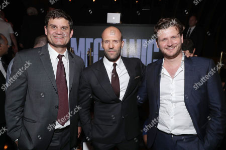 """Jason Constantine, President of Acquisitions and Co-Productions, Lionsgate Motion Picture Group, Jason Statham and Director Dennis Gansel seen at Los Angeles Premiere of """"Mechanic: Resurrection"""" from Lionsgate's Summit Premiere Label at ArcLight Hollywood, in Los Angeles"""