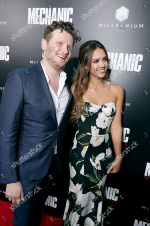 """Director Dennis Gansel and Jessica Alba seen at Los Angeles Premiere of """"Mechanic: Resurrection"""" from Lionsgate's Summit Premiere Label at ArcLight Hollywood, in Los Angeles"""