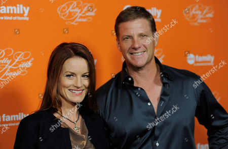 "Laura Leighton, a cast member in ""Pretty Little Liars,"" poses with her husband Doug Savant at a screening of a special Halloween episode of the television series at Hollywood Forever Cemetery, in Los Angeles"