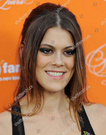 "Lindsey Shaw, a cast member in ""Pretty Little Liars,"" poses at a screening of a special Halloween episode of the television series at Hollywood Forever Cemetery, in Los Angeles"