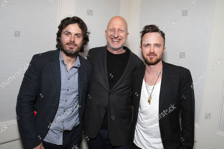 Stock Photo of Exclusive - Casey Affleck, Director John Hillcoat and Aaron Paul seen at a Private Screening of Open Road's 'Triple 9' hosted by John Hellcoat, Casey Affleck, Aaron Paul and Atticus Ross at the London Hotel West Hollywood, in West Hollywood, CA