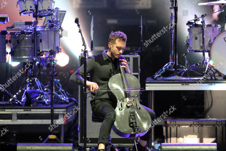 Brent Kutzle with OneRepublic performs during the Q100 Moon Shine Grind at Verizon Wireless Amphitheatre at Encore Park, in Alpharetta