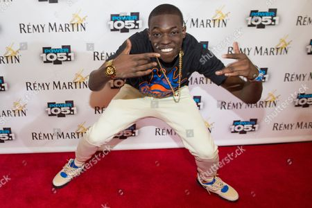 Bobby Shmurda arrives at Power 105.1's Powerhouse 2014 at Barclays Center in Brooklyn, New York. Shmurda whose real name is Ackquille Pollard has been arrested in New York City in a gun and narcotics investigation. Authorities said, that he was apprehended after leaving a Manhattan recording studio. Several others were also taken into custody