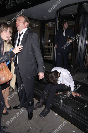 Phillip Glenister walks past a drunk