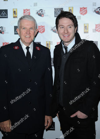 Major George Hood, left, and Adam Young are seen at Rock The Red Kettle to benefit The Salvation Army, part of AEG's Season Of Giving at L.A. LIVE,, at LA Live in Los Angeles