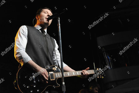 Adam Young of Owl City performs at The Rock The Red Kettle Concert,, at LA Live in Los Angeles