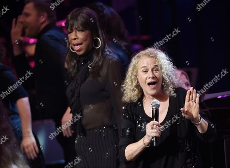 Singer Carole King, right, is joined by Natalie Cole onstage during the finale of the SeriousFun Children's Network event at the Dolby Theatre, in Los Angeles. Founded by actor Paul Newman in 1988, the network is a global community of 30 camps and programs serving children living with serious illnesses
