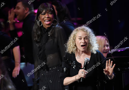 Singer Carole King, right, is joined by Natalie Cole onstage during the finale of the SeriousFun Children's Network event at the Dolby Theatre, in Los Angeles. Founded by the actor Paul Newman in 1988, the network is a global community of 30 camps and programs serving children living with serious illnesses