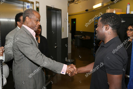 "From left, actor Sidney Poitier congratulates writer/cast member Daniel Beaty backstage after the performance of ""The Tallest Tree in the Forest"" at the Center Theatre Group/Mark Taper Forum, in Los Angeles, Calif"