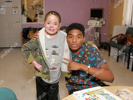 Nadji Jeter (right) and a patient at Starlight Children's Foundation's Fun Center dedication at Childrens Hospital Los Angeles, in Los Angeles