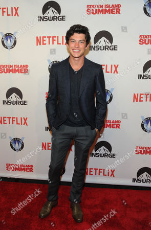 Actor Graham Phillips poses on the red carpet at the premiere of the movie Staten Island Summer at Sunshine Cinema, in New York. The new comedy debuts on Netflix on July 30, 2015 and is available for Digital download