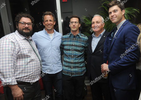 Seth Meyers, second left, and Andy Samberg, center, join producer Lorne Michaels and screenwriter Colin Jost, right, and actor Bobby Moynihan to celebrate the movie Staten Island Summer at an after party at The Standard, East Village, in New York. The new comedy debuts on Netflix on July 30, 2015 and is available for Digital download