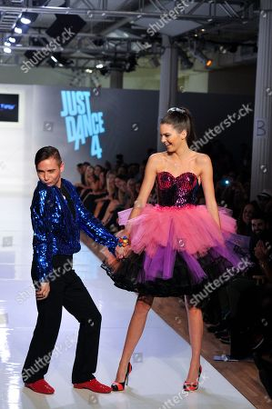 Designer Michael Kuluva and Kendall Jenner walk the runway at the Just Dance 4 show during Fashion Week, in New York