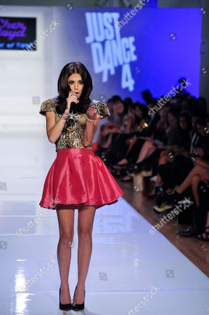 Just Dance 4 track list artist Cher Lloyd performs her hit single Want U Back at the Just Dance 4 fashion show during Fashion Week, in New York