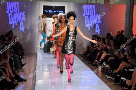 Models walk the runway in Just Dance 4 inspired looks by Tumbler and Tipsy during Fashion Week, in New York