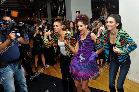 Alex Morgan, left, Kristin Adams and Kendall Jenner play the Just Dance 4 video game at the Just Dance 4 show during Fashion Week, in New York