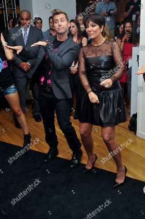Stock Photo of Lance Bass and Kris Jenner play the Just Dance 4 video game at the Just Dance 4 show during Fashion Week, in New York